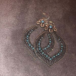 Fun shaped earrings with blue accent